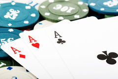 Playing cards and gambling chips Royalty Free Stock Image