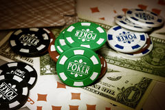 Playing cards, gambling chips and dollars Stock Photography