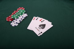 Playing cards and gambling chips Royalty Free Stock Photos