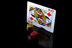 Playing cards and game dice stock photos