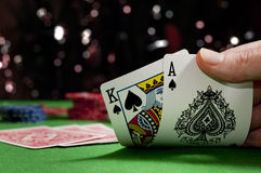 Playing cards in a game of poker. A poker player shows an Ace & King of Spades in a casino Royalty Free Stock Image
