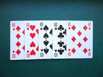 Playing cards on green background stock photo