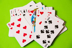 Playing cards on green casino background Royalty Free Stock Images