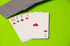 Playing cards on green casino background Stock Image