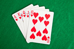 Playing cards on a green cloth Royalty Free Stock Images