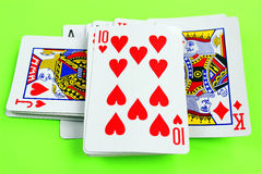 Playing cards on green table Stock Photo