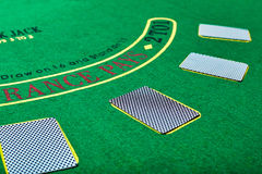 Playing cards on green table surface. Casino, gambling, poker concept Royalty Free Stock Photo