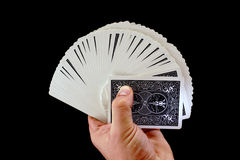 Playing cards in hand Stock Images