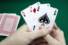 Playing cards in a hand Royalty Free Stock Photo