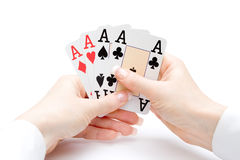 Playing cards - hand of four aces. Woman hands holding playing cards with four aces combination Stock Photography