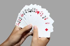 Playing cards in hand Royalty Free Stock Image