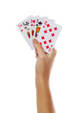Playing cards in hand isolated on white background Royalty Free Stock Photography