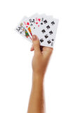 Playing cards in hand isolated on white background Stock Image