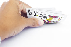 Playing cards in hand  on white background Stock Photo