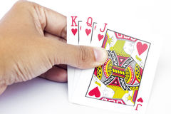 Playing cards in hand  on white background Royalty Free Stock Images
