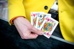 Playing cards. In the hands of a magician Royalty Free Stock Photography