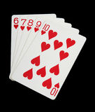Playing cards, hearts. Hearts - playing cards on black background royalty free stock photography