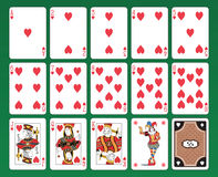 Playing cards of Hearts. Set of playing cards on green background. The figures are original design as well as the jolly, the ace of spades and the back card Stock Image