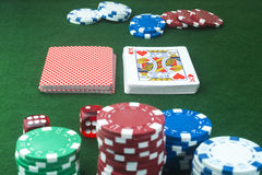 Playing cards hearts cut Dice Poker chips Royalty Free Stock Photography