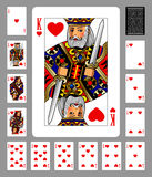 Playing cards of Hearts suit and back on green background Royalty Free Stock Images