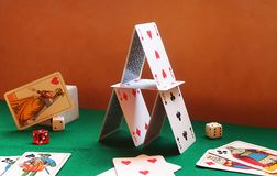 Playing cards. House of cards and dices Stock Images