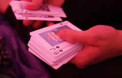 Playing cards. Human hands holding playing cards Stock Photos