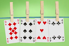 Playing cards hung on clothesline Stock Photography