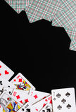 Playing cards inverted. Background playing cards. Frame with playing cards and black background Stock Image