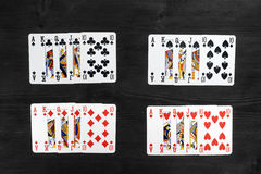 Playing cards isolated on black background Stock Images