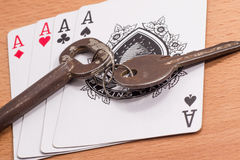 Playing cards and keys Royalty Free Stock Photography