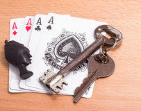 Playing cards and keys mascot Royalty Free Stock Images
