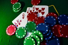 Royal flush, straight made of hearts with poker chips on table royalty free stock photo