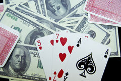 Playing cards and money stock image