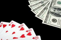 Playing cards and money on black background Royalty Free Stock Photo