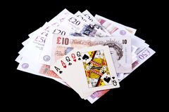 Playing cards and money Stock Photos