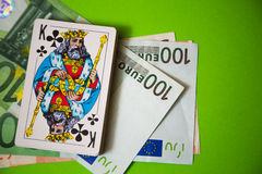 Playing cards over euro money Stock Photography