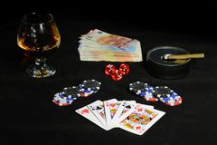 Playing cards for the poker on a black background Royalty Free Stock Photos