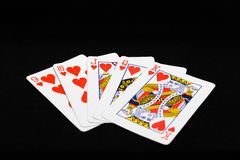 Playing cards for the poker on a black background Stock Photography