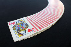 Playing cards poker casino.  on black poker table background. The combination of playing cards poker casino.  on black poker table background Royalty Free Stock Photography