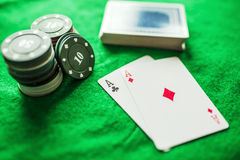 Playing cards poker chips and aces. Playing cards poker chips and two aces Stock Image