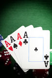 Playing cards, poker chips, and dices on green table Stock Image