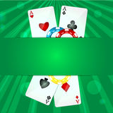 Playing cards and poker chips. On a green background Royalty Free Stock Photos
