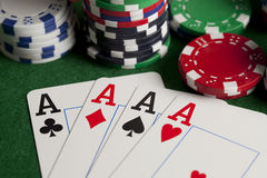 Playing cards and poker chips on green table Royalty Free Stock Images