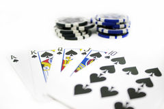 Playing Cards and Poker Chips Isolated on White Background Royalty Free Stock Image