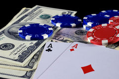 Playing cards, poker chips and money stock photography