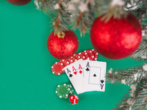 Playing cards and poker chips near a Christmas tree royalty free stock photos