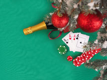 Playing cards and poker chips near a Christmas tree Stock Images