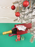 Playing cards and poker chips near a Christmas tree Royalty Free Stock Photography