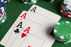 Playing cards and poker chips on table Stock Images