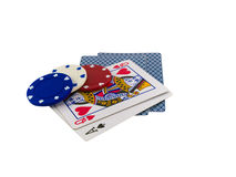 Playing Cards with Poker Chips on White Stock Photo